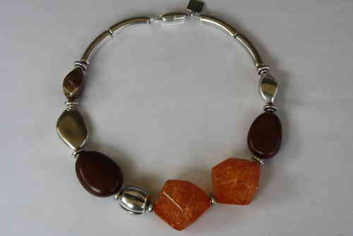 necklace with brown pebbles 26x37mm, orange-colored meteorite 35x41mm, silver ton 24x24mm and silver leaf 33x40mm